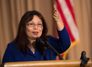 """U.S. Congresswoman Tammy Duckworth (D.-Ill.) is the keynote speaker at the 2013 U.S. Department of Agriculture (USDA), Veterans' Day Observance, whose theme is """"VALOR, COURAGE, SACRIFICE – HONORING ALL WHO SERVED,"""" in Washington, DC, on Wednesday, November 20, 2013. Congresswoman Tammy Duckworth is an Iraq War Veteran and former Assistant Secretary of Veterans Affairs. In 2004, Duckworth was deployed to Iraq as a Blackhawk helicopter pilot for the Illinois Army National Guard. She was one of the first Army women to fly combat missions during Operation Iraqi Freedom until her Blackhawk helicopter was hit by an RPG on November 12, 2004. Duckworth lost her legs and partial use of her right arm in the explosion and was awarded a Purple Heart for her combat injuries. Duckworth declined a military medical retirement and continues to drill as a Lieutenant Colonel in the Illinois Army National Guard. USDA photo by Lance Cheung."""